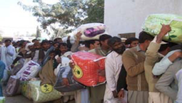 Distribution of Food Packs in Bakkhar sponsored by King Abdullah Campaign for Pakistani people